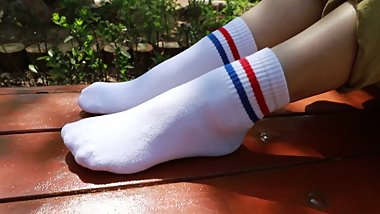 Chinese girl teases with her two stripe white crew socks