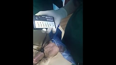 Chinese doctor give patient treatment with surgical uniform latex glove 2