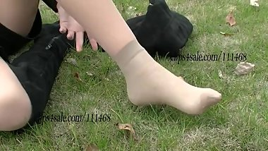 Chinese girl wears a sock beneath thick tan nylon for her sprained ankle