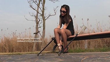 Chinese girl crutching with bandaged ankle wearing tan nylon