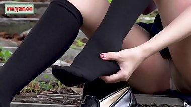 Chinese schoolgirl wearing knee high black socks over tan nylon