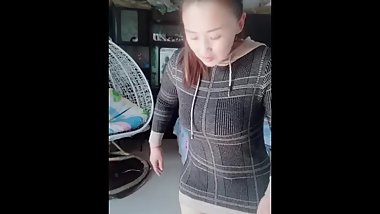 Chinese high RAK amputee plump putting on leg with leather staps