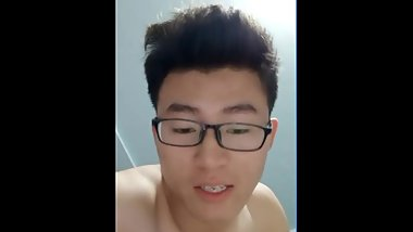 Chinese dude with glasses fucks his boy hard