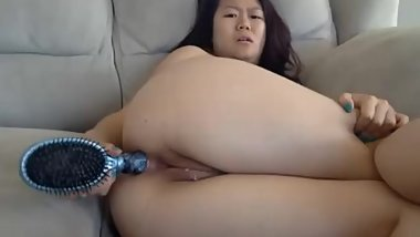 chinese girl fucking her asshole with hair brush, and rubbing her pussy