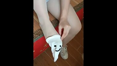 Chinese girl sprains foot in tan nylon
