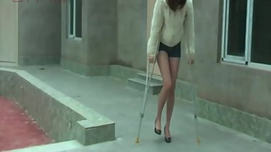 Leggy Chinese girl gives her sprained ankle first a bandage wrap then a SLC