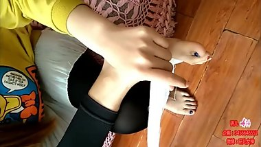 Chinese girl bandaging sole with black leggings