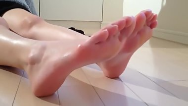 Japanese girl strips socks and shows feet