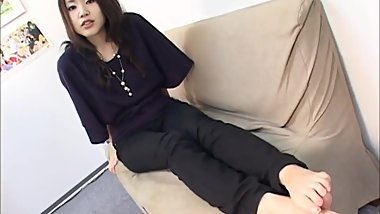 Japanese girl's smooth feet on couch