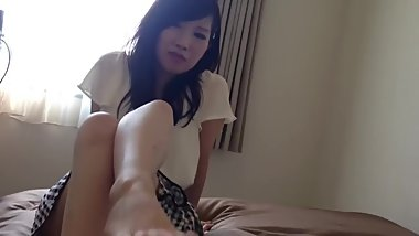 Cute Japanese girl's feet in bed