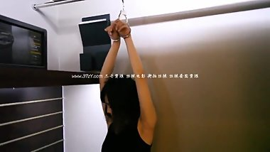 Beautiful Chinese Girl Trying Cuffs and Rope