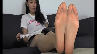 Asian girl showing pantyhose soles